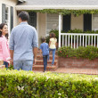 Hispanic family outside home for rent - Stock Photo