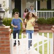 Hispanic family outside home — Stock Photo