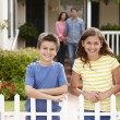 Hispanic family outside home — Stock Photo #11884497