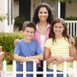 Royalty-Free Stock Photo: Mother and children outside home