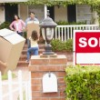 Family moving into new home - Stock Photo