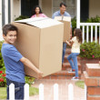 Stock Photo: Family moving into rented house
