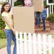 Family moving into new house — Stock Photo