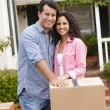 Hispanic couple moving into new house - Stock Photo