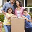 Foto Stock: Family moving into new house