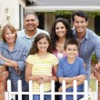Hispanic family outside home — Stock Photo #11884522