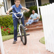 Stock Photo: Boy and grandfather at home with bike