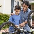 Father and son fixing bike — Stock Photo #11884535