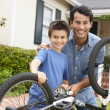 Father and son fixing bike — Stock Photo