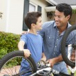 Father and son fixing bike — Stock Photo #11884543