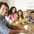 Hispanic family eating breakfast — Stock Photo #11884554