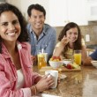 Hispanic family eating breakfast — Stock Photo