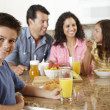 Hispanic family eating breakfast — Stock Photo #11884558