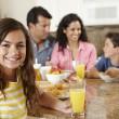 Hispanic family eating breakfast — Stock Photo