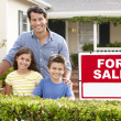 Stock Photo: Father and children outside home for sale