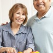 Stock Photo: Senior couple cooking
