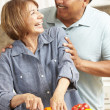 Senior couple cooking — Stock Photo