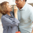 Senior couple cooking — Stock Photo #11884615