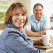Senior couple relaxing in kitchen — Stock Photo #11884617