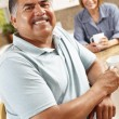 Senior couple relaxing in kitchen — Stock Photo