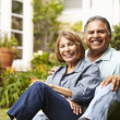 Senior couple relaxing in garden - Stock Photo