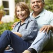 Senior couple relaxing in garden — Stock Photo #11884634