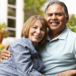 Senior couple relaxing in garden — Stock Photo #11884636