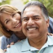 Stock Photo: Senior couple relaxing in garden
