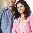 Hispanic couple cooking - Stock Photo