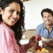 Hispanic couple eating cereal and fruit — Stock Photo