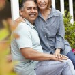 Senior couple relaxing in garden — Stock Photo #11884690
