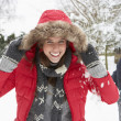 Young couple having snowball fight — Stok fotoğraf