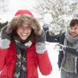 Young couple having snowball fight — Stock Photo #11884739
