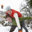 Young couple having fun in snow — Stock Photo