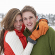 Young couple in snow — Stock Photo