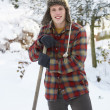 Young man clearing snow — Lizenzfreies Foto