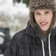 Young man in snow — Stock Photo