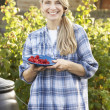 Woman with home-grown fruit — Stock Photo