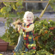 Young child on allotment — Foto de Stock