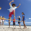 Teenagers having fun on beach - Stock Photo