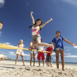 Teenagers having fun on beach — Stock Photo