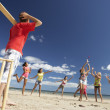 Teenagers playing cricket on beach — Lizenzfreies Foto