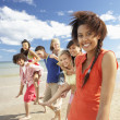 Teenagers walking on beach - Stock Photo