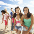 Stock Photo: Teenagers walking on beach