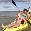 Teenagers in sea with canoe — Stock Photo