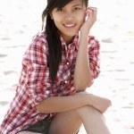 Portrait teenage girl on beach — Stock Photo #11884924