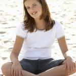 Portrait teenage girl on beach — Stock Photo #11884927
