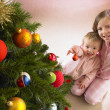 Children with Christmas tree — Stok fotoğraf