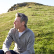Man in countryside — Stock Photo