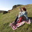 Couple on country picnic — Stock Photo